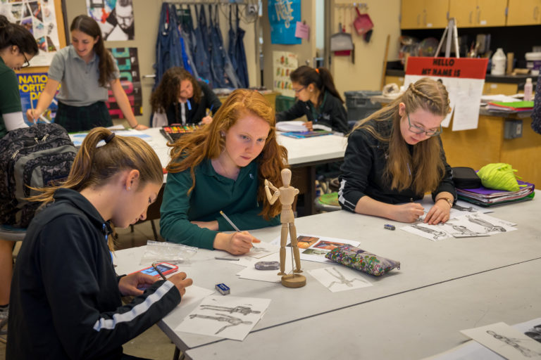 Students hard at work in Art Class.